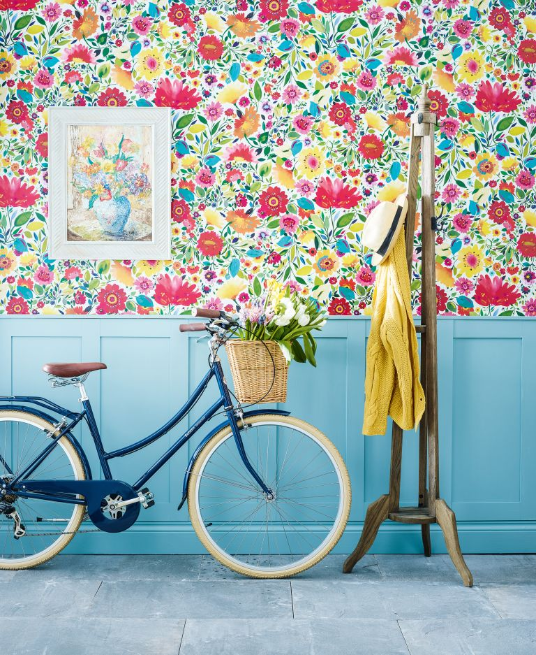 floral wallpaper with blue panelling, bike and coat rack