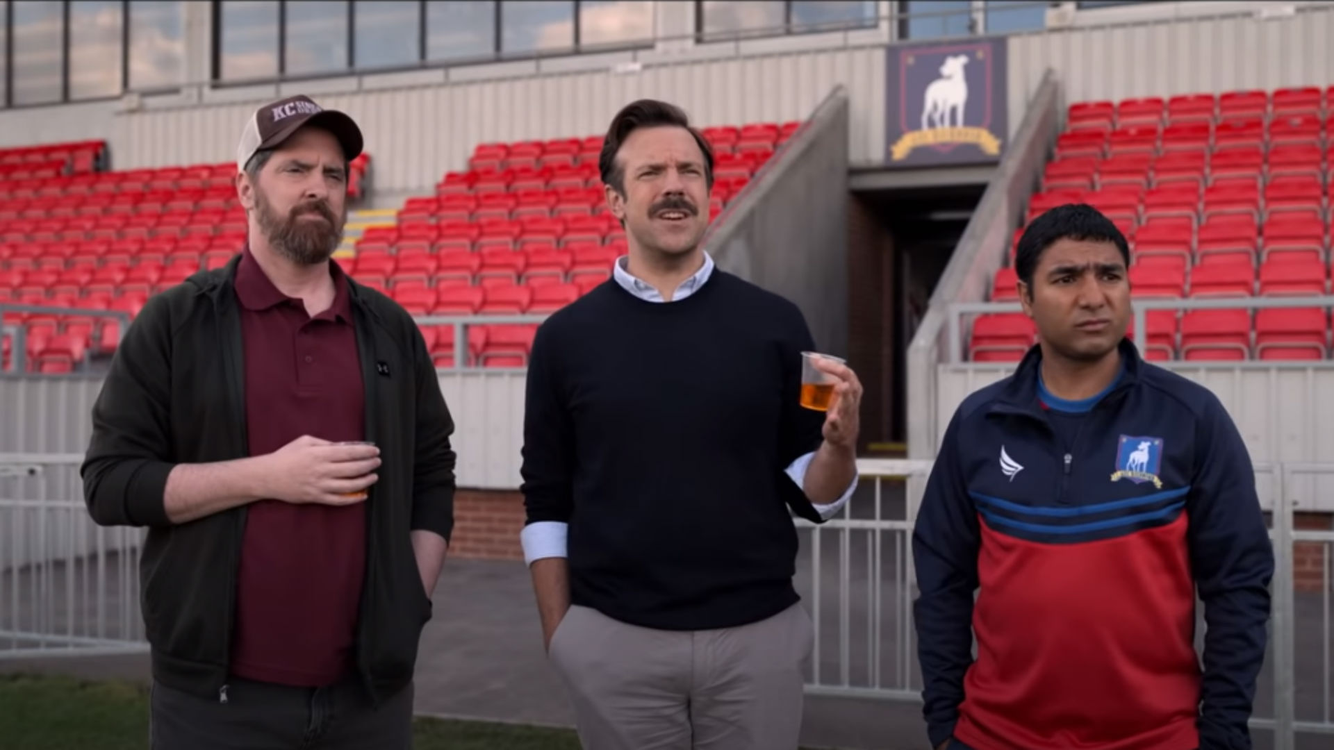 Ted Lasso, Coach Beard and Nate the Great watch a training session