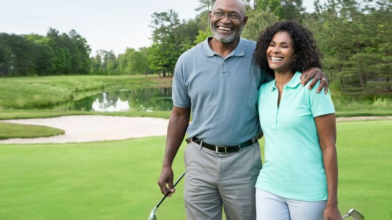 Happy couple pictured on a golf course