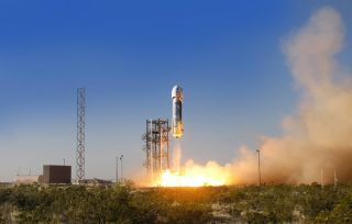 Blue Origin's privately built New Shepard passenger ship launches on a suborbtial test flight from West Texas on April 29, 2015.