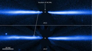 Hubble Space Telescope images of the debris disk surrounding a star called AU Microscopii show the same structure migrating outward.