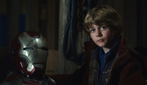 Iron Man 3 Harley looking at Tony, next to his armor