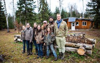 Ben Fogle: New Lives in the Wild. Shows Rose, Jeff, Sarah, Abigail, Julia, Chrstina, Keziah Burkinshaw with Ben outside house