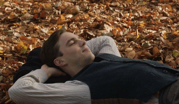 Tolkien Nicholas Hoult laying on leaves