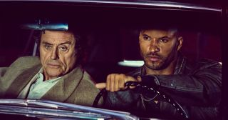 Ricky Whittle and Ian McShane in American Gods.