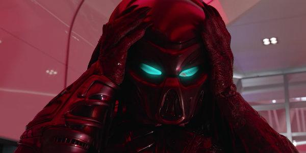 The Predator putting on mask