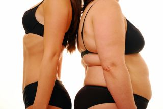 A heavy woman stands back-to-back with a thin woman.