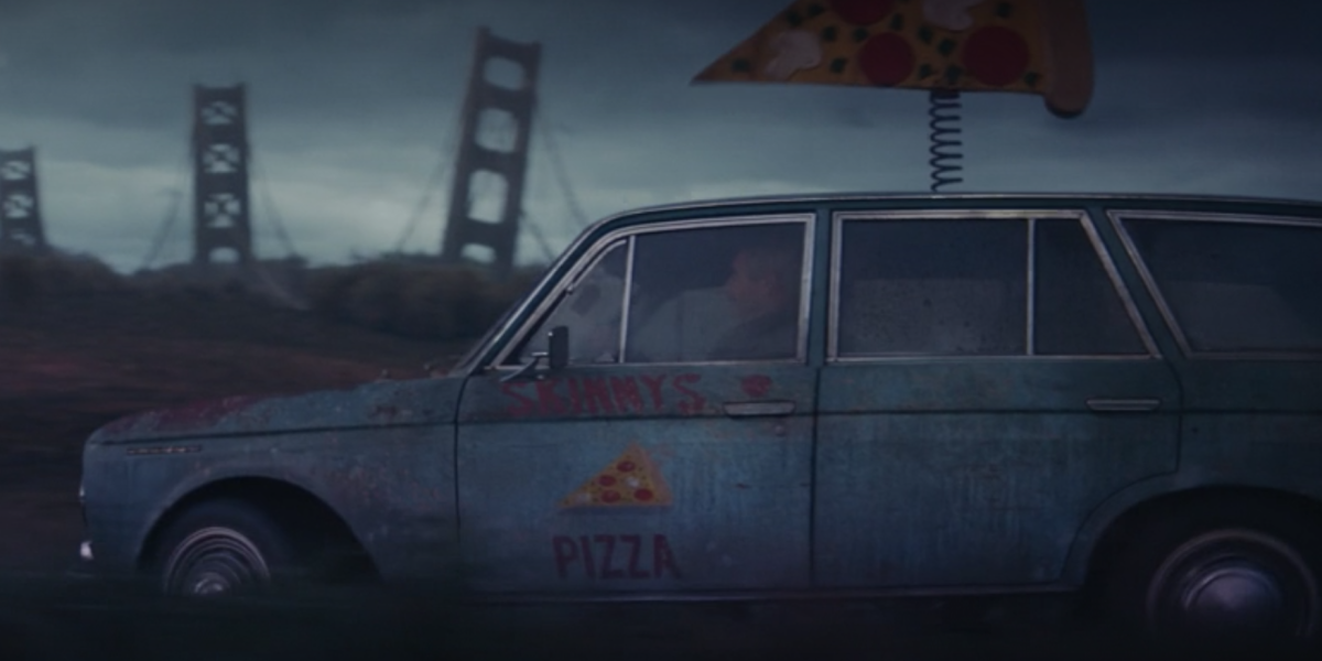 mobius and sylvie riding in skinny's pizza car in loki episode 5