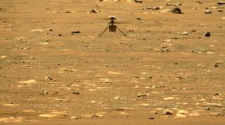 NASA's Mars helicopter Ingenuity flies on the Red Planet for the second time ever, on April 22, 2021. This image was captured by the Mastcam-Z camera system aboard NASA's Perseverance rover.