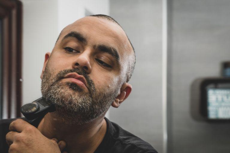 Man shaving beard