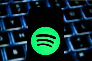 Spotify logo seen displayed on a smartphone