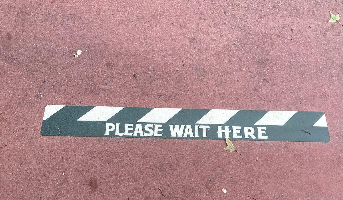 Please Wait Here Sign at Magic Kingdom