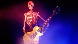 Photo of a skeleton playing electric guitar
