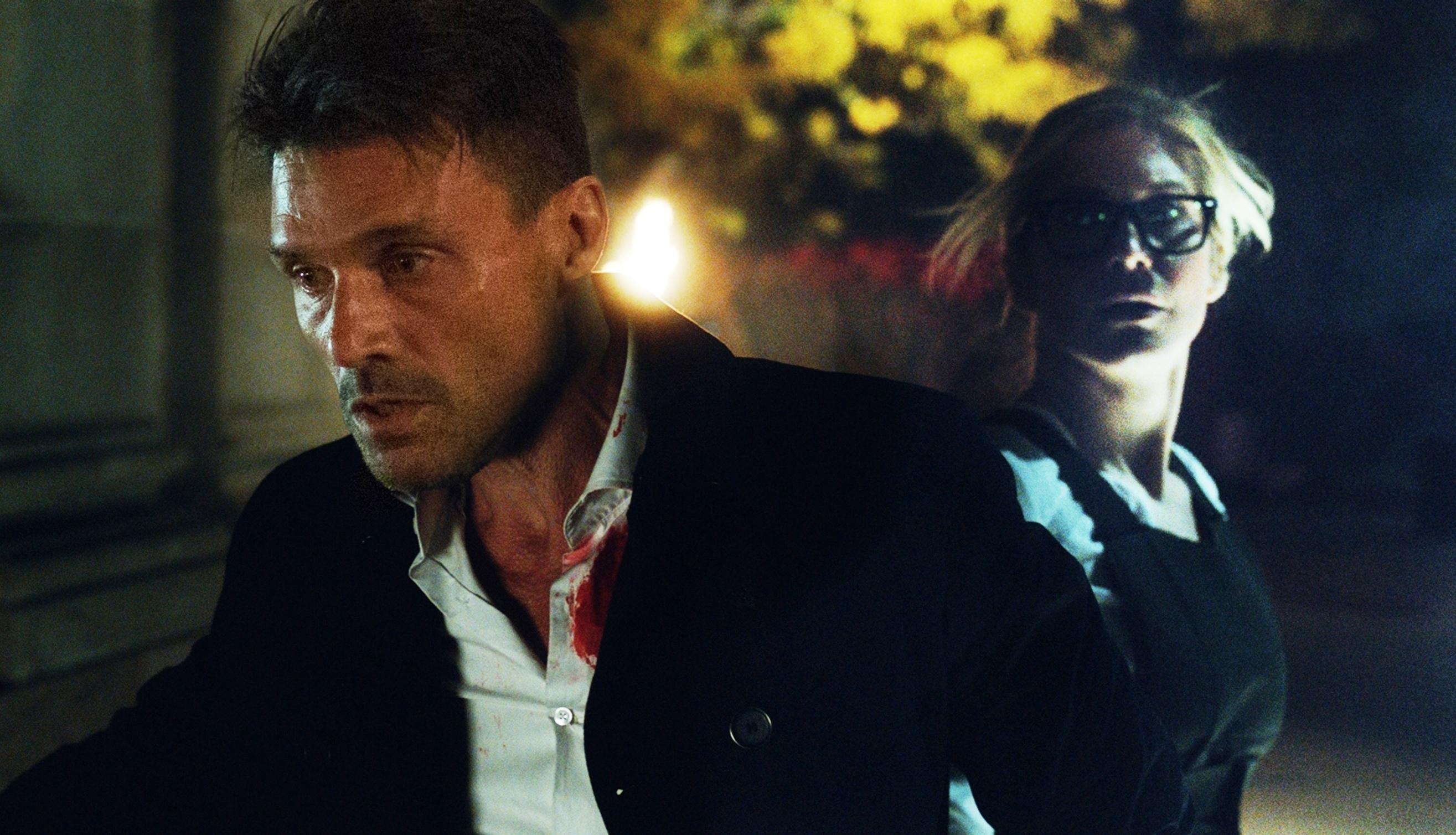 Frank Grillo and Elizabeth Mitchell on the run in The Purge: Election Year.