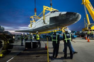 Shuttle Endeavour is hoisted off its Shuttle Carrier Aircraft at LAX on Sept. 22, 2012.