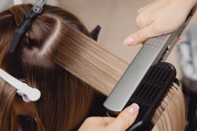 Best hair straighteners: brunette hair being straightened