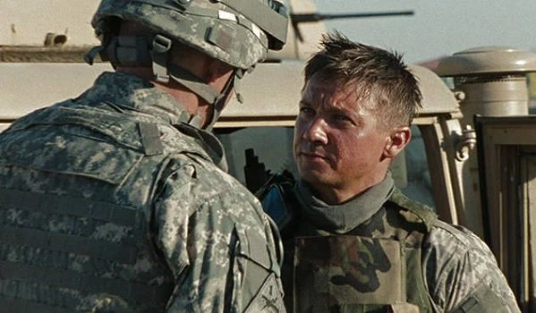 The Hurt Locker Jeremy Renner speaking with a fellow soldier in front of a Hummer