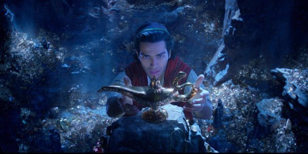 Aladdin pulling the lamp from the cave of wonders