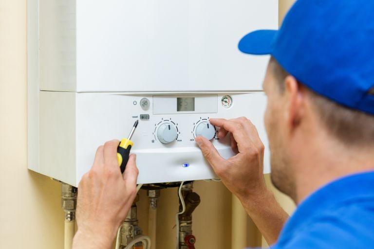 Carbon monoxide poisoning: Man fixing boiler
