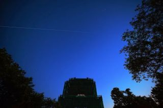 China's space station core module 'Tianhe' flies over the Bell Tower on May 2, 2021 in Beijing, China.