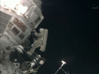 Russian cosmonaut Pavel Vinogradov, the world's oldest spacewalker, floats outside the International Space Station near the end of a 6.5-hour spacewalk on April 19, 2013.
