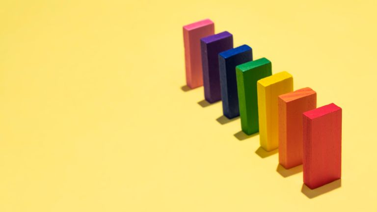 colourful rectangle shaped blocks on yellow background