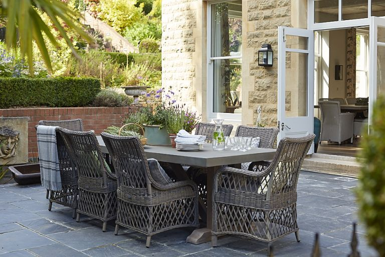 Sims Hilditch family home outdoor dining area with wicker chairs