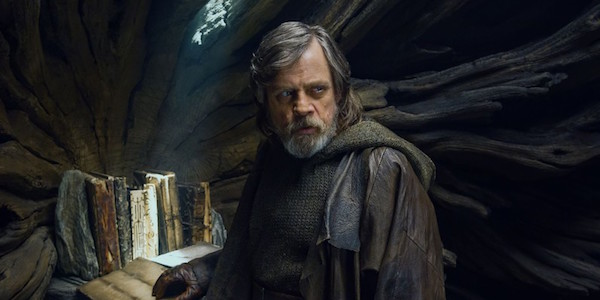 Luke with the ancient Jedi text