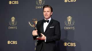 Ewan McGregor poses with his Emmy for Halston on September 19, 2021