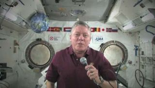 NASA astronaut Mike Fossum, commander of the Expedition 29 crew on the International Space Station, offers a video tribute to armed servicemen and women for U.S. Veteran's Day on Nov. 11, 2011.