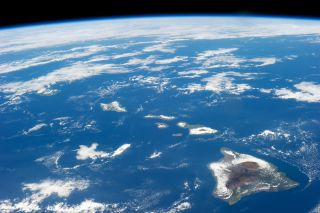 Hawaii is seen from space, all alone in a big ocean.