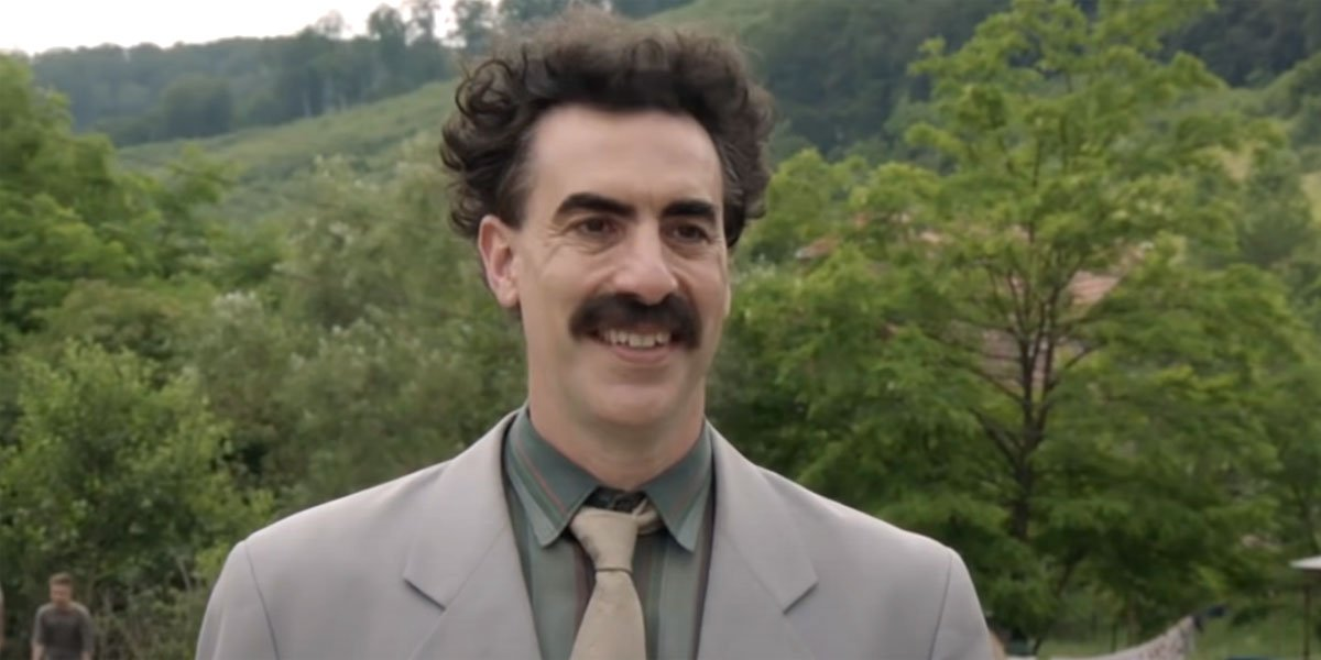 Borat smiling and ready to head to America again.