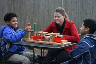 children playig a fairness game
