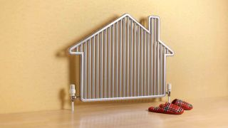 Best gas furnaces: An image of a white radiator shaped like a house and sat against a yellow wall