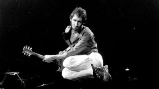 """Pete Townshend of the rock and roll band """"The Who"""" leaps as he plays his electric guitar while performing onstage in circa 1978."""
