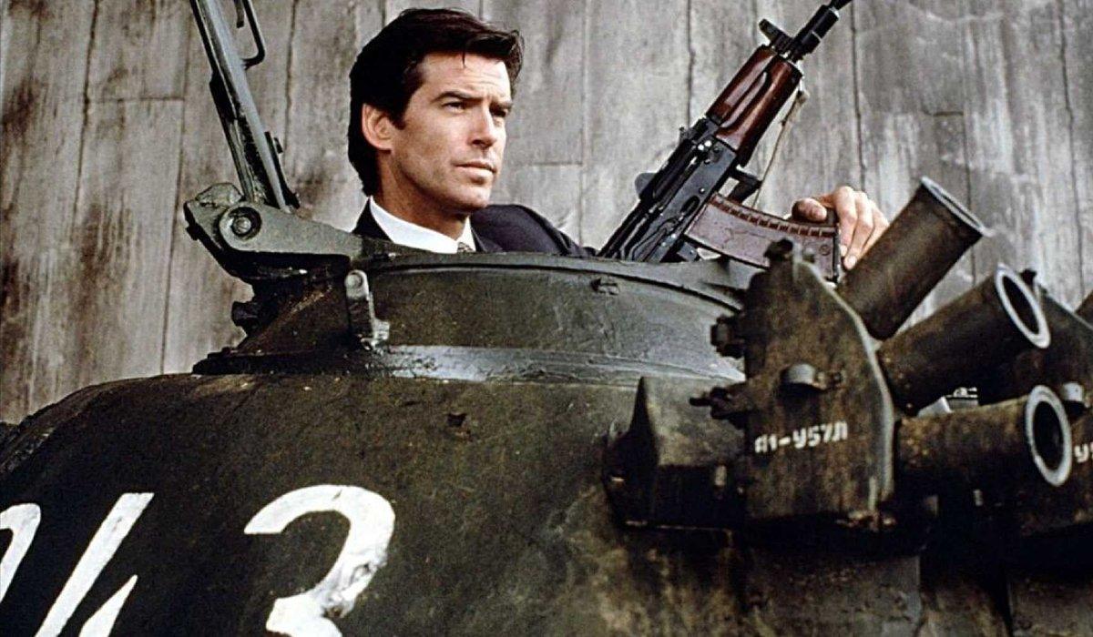 Goldeneye Pierce Brosnan peeks out of a tank with a gun