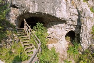 the entrance to the Denisova Cave in southern Siberia