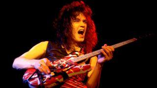 Eddie Van Halen (1955 - 2020), of the group Van Halen, performs onstage at the Aragon Ballroom, Chicago, Illinois, April 26, 1979