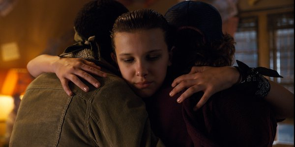 Eleven hugging Dustin and Lucas