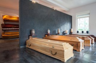Coffins lined up on display at a funeral home.