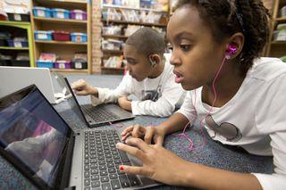 Kids using broadband in school