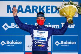 MAARKEDAL BELGIUM JUNE 09 Remco Evenepoel of Belgium and Team Deceuninck QuickStep Blue leader jersey celebrates at podium during the 90th Baloise Belgium Tour 2021 Stage 1 a 1753km stage from Beveren to Maarkedal Mask Covid safety measures baloisebelgiumtour on June 09 2021 in Maarkedal Belgium Photo by Bas CzerwinskiGetty Images
