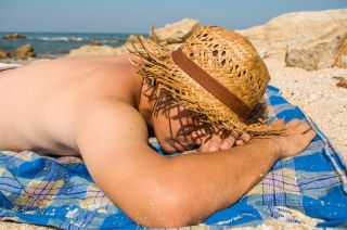 Man sleeping on beach
