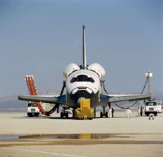 This head-on photograph of NASA's space shuttle Columbia was taken during post-landing servicing on Rogers dry lake bed at Edwards Air Force Base in southern California. The STS-1 mission ended earlier today, two and one third days later and thousands of