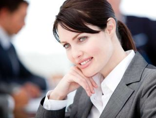 Assertive businesswoman in a meeting with her team