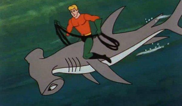 Aquaman riding shark