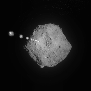 An image overlay shows one of Hayabusa2's target markers falling slowly to the surface of the asteroid Ryugu on Sept. 16, 2019.
