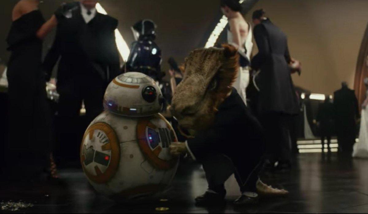 Star Wars: The Last Jedi a casino patron puts a coin in BB-8
