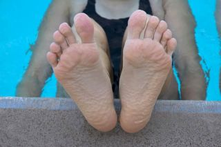 woman's pruney toes in pool