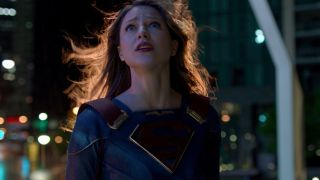 Supergirl looking at the sky worriedly